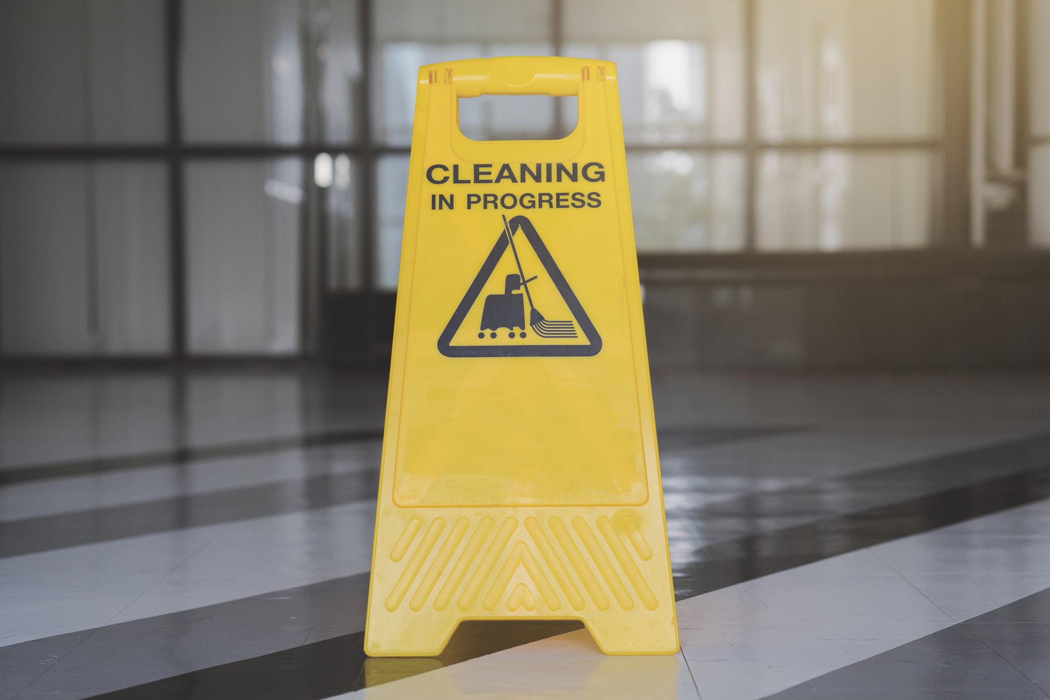 cleaning progress caution sign in office background
